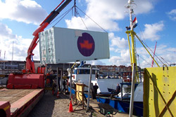 The container being put on the ship